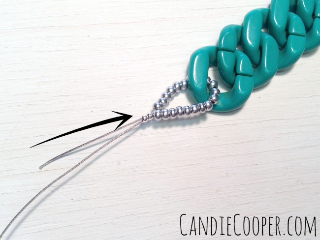 Slide crimps up next to seed beads